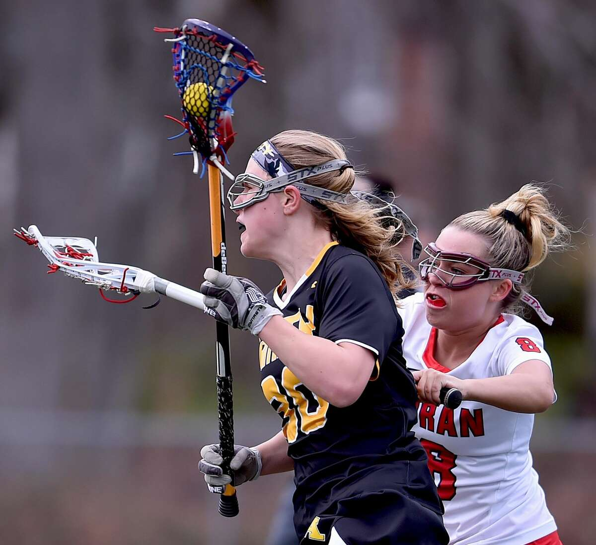 Amity's Ana Carney battles Foran's Emily Kwalek during Thursday's game in Milford.