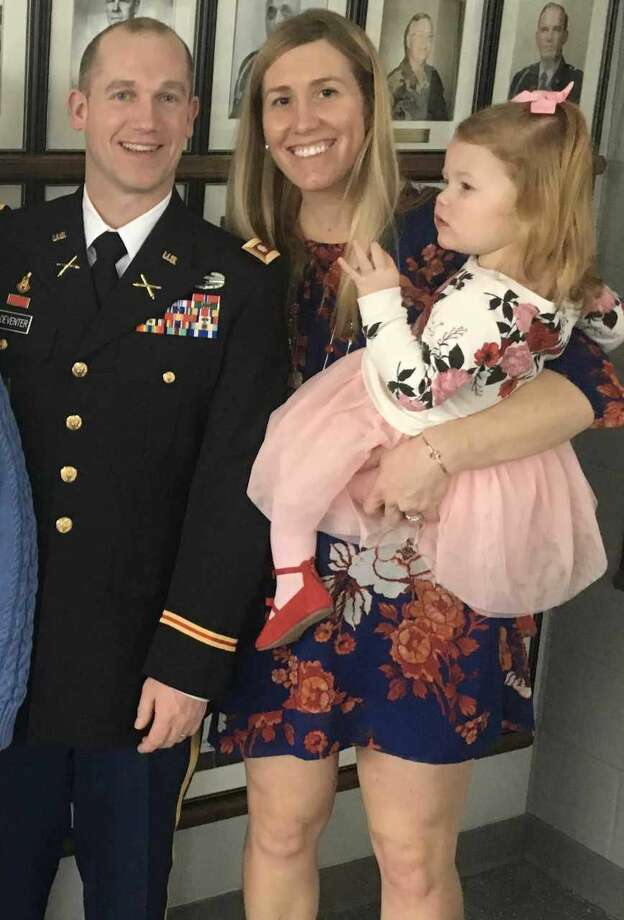 Keynote speaker Army National Guard Lt. Col. Timothy VanDeventer, with his wife and daughter.