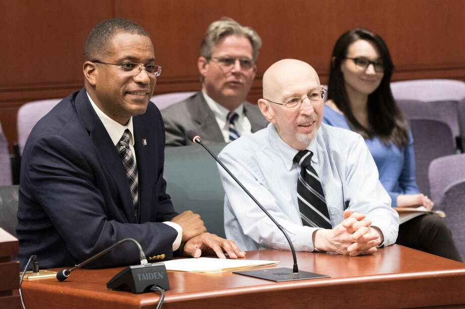 Herb Kolodny of Hamden, co-founder of the Connecticut Amputee Network, seated with Sen. George Logan, R-Ansonia, during testimony for a bill that addresses insurance parity for high-tech prosthetic limbs.