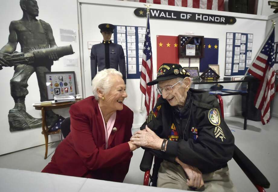 World War II veteran Robert Swirsky of Orange, 98, and Hedwige Kuepper of Milford, 87, have a quiet moment at the West Haven Veterans Museum and Learning Center.