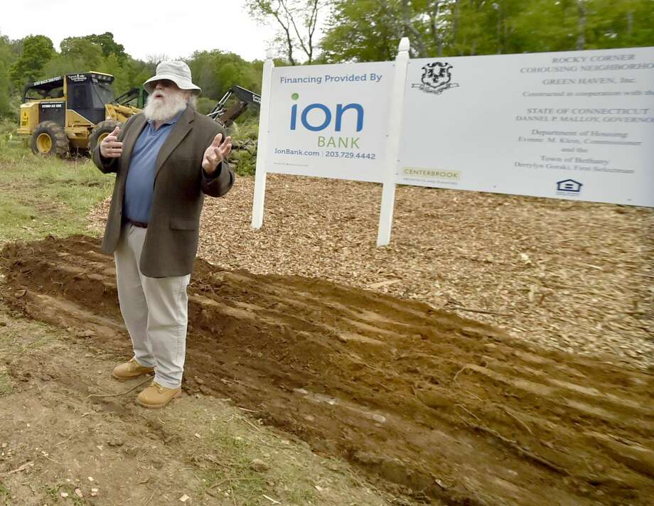 Dick Margulis of New Haven, president of Green Haven Inc., talks about development of the Rocky Corner housing development in Bethany during a ground-breaking Tuesday.