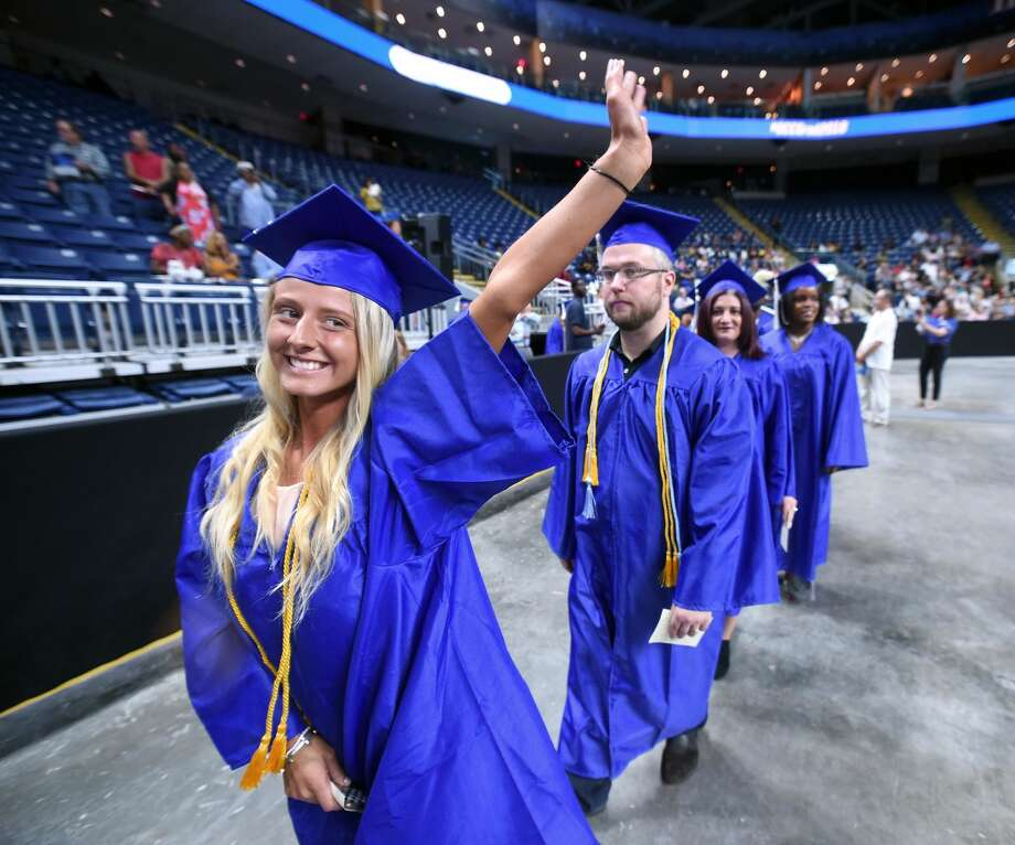 Kayleigh Roy of Wallingford waves to family as she enters Webster Bank Arena for Gateway Community College's commencement exercises Friday.