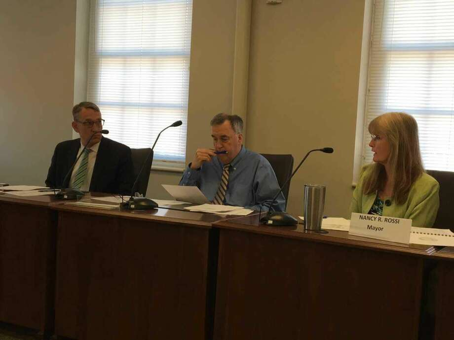 West Haven Mayor Nancy Rossi, right, speaks to state Municipal Accountability Review Board Chairman Benjamin Barnes on Thursday, May 24, at a meeting of the state Municipal Accountability Review Board's Ad Hoc Committee for West Haven.