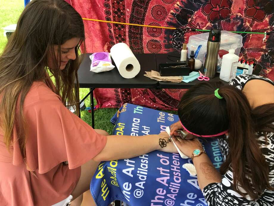 Rene Minnocci has her hand painted at the event.
