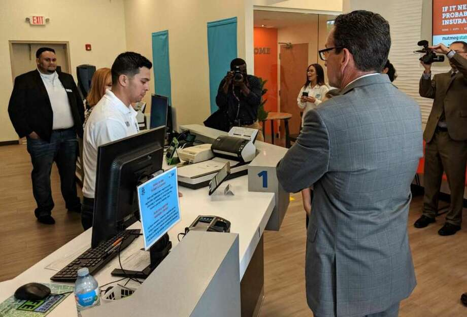 Governor Dannel P. Malloy at the new DMV Express Center at the Nutmeg State Financial Credit Union at 977 Boston Post Road in Milford.