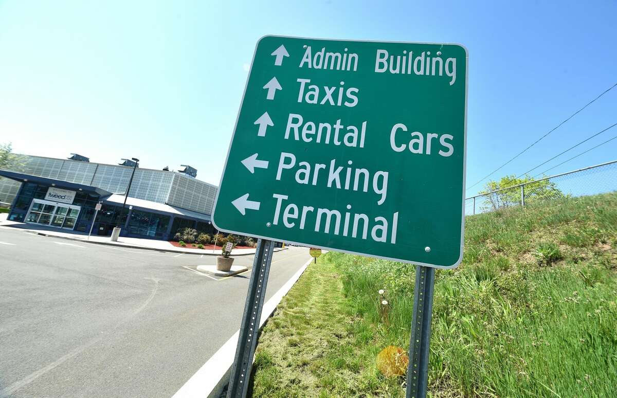 A sign directs travelers at Tweed New Haven Regional Airport on May 8, 2018.
