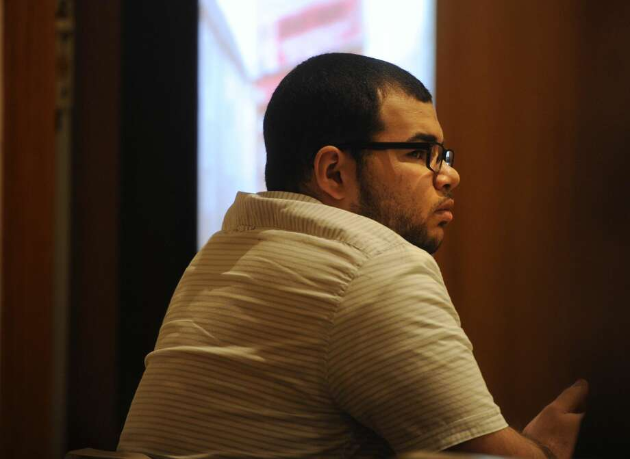 Treizy Lopez, of West Haven, listens to testimony as the state presents its case in his trial for the April 11, 2015 murder of popular Bridgeport store owner Jose Salgado in Superior Court in Bridgeport.