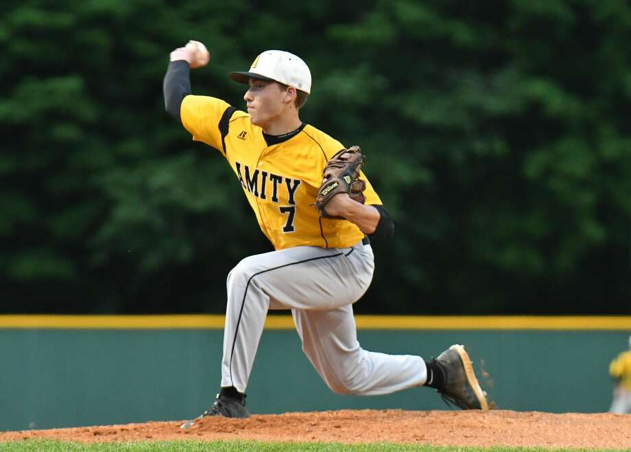 John Lumpinski (7) of the Amity Spartans delivers a pitch during the Class LL baseball semifinal round against the Ridgefield Tigers on Wednesday June 6, 2018, at Municipal Stadium in Waterbury, Connecticut.