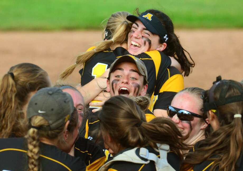 Amity celebrates its win over Trumbull in the Class title game on Saturday,