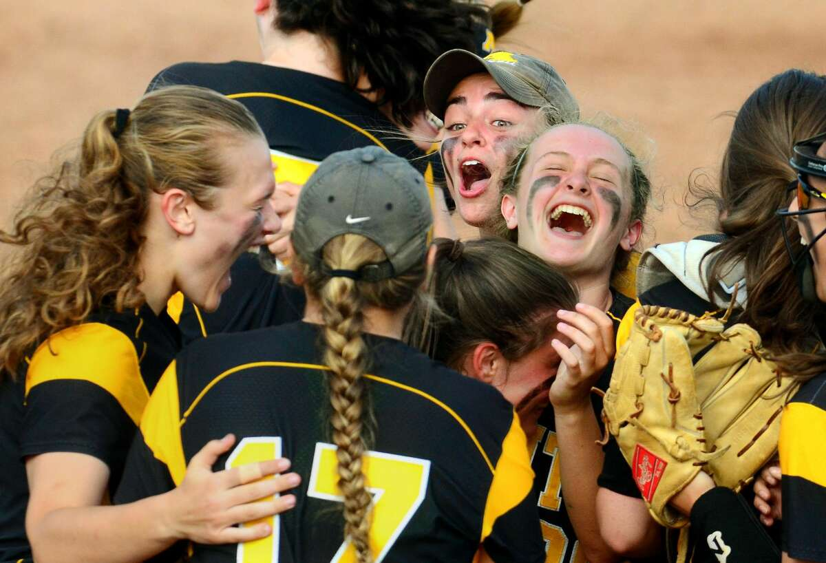 Amity celebrates its win over Trumbull in Class LL softball championship action in West Haven, Conn. on Saturday June 9, 2018.