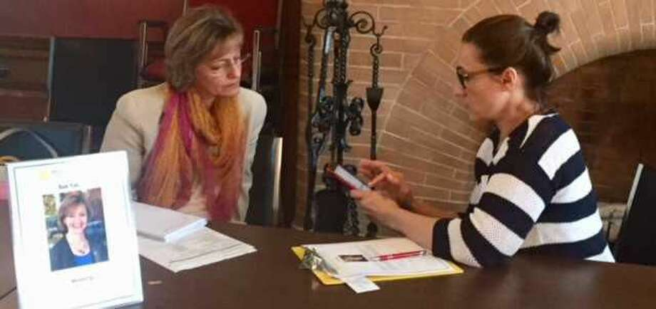 Counselor Sue Yasav, left, with client Carol Elstein at the event.