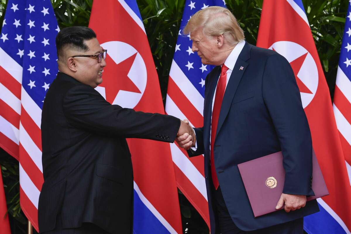 North Korea leader Kim Jong Un and U.S. President Donald Trump shake hands at the conclusion of their meetings at the Capella resort on Sentosa Island Tuesday, June 12, 2018 in Singapore.