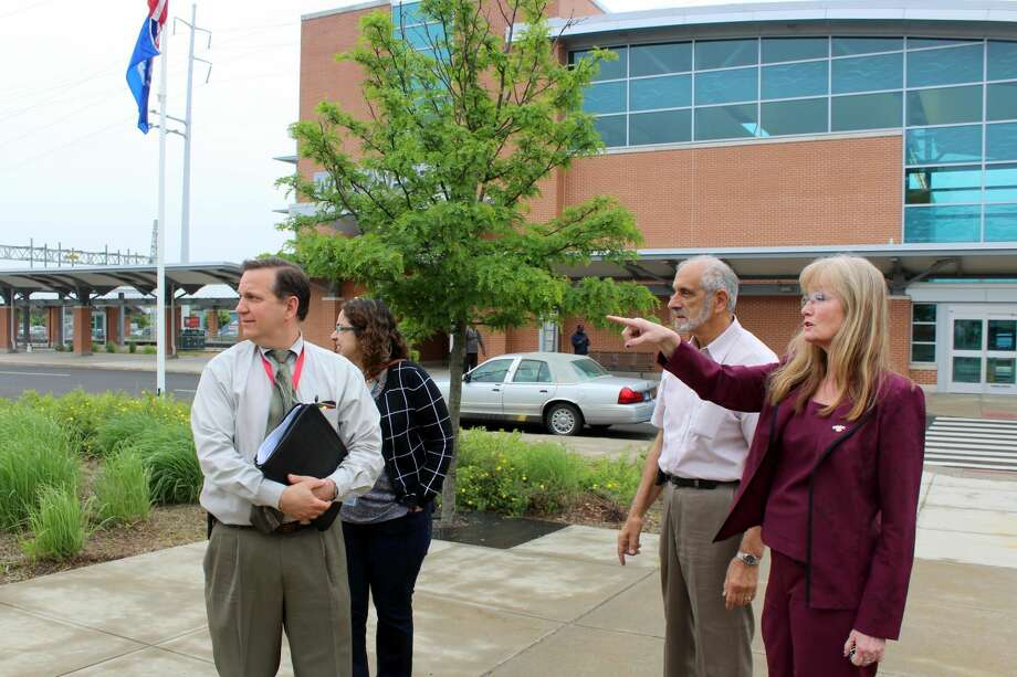 West Haven Mayor Nancy Rossi, with acting Public Works Commissioner Lou Esposito, right, discusses landscaping and property maintenance of the West Haven train station with state DOT Assistant Rail Administrator Richard T. Jankovich and DOT Transportation Rail Officer Marlene Cordero.