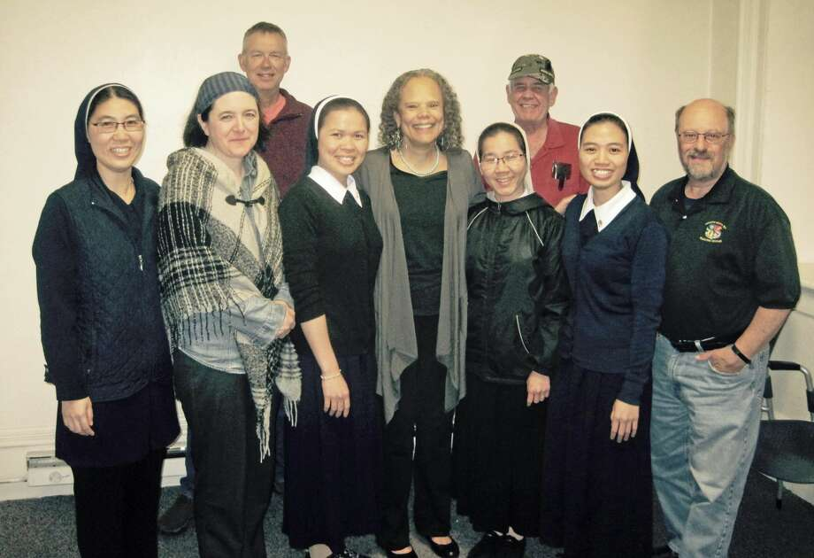 The veterans writing group at Middletown's Russell Library was treated this week to a visit from Vietnamese sisters from the Holy Apostles College & Seminary in Cromwell. The women, who have been in Cromwell for eight months and are learning the English language, sang native songs for members.