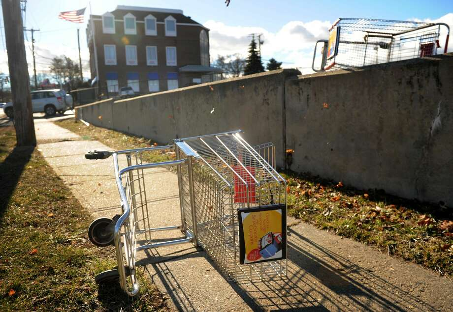 Shopping carts are blown from the parking lot outside Xpect Discounts at the intersection of High Street and the Post Road in Milford on Jan. 31, 2013.