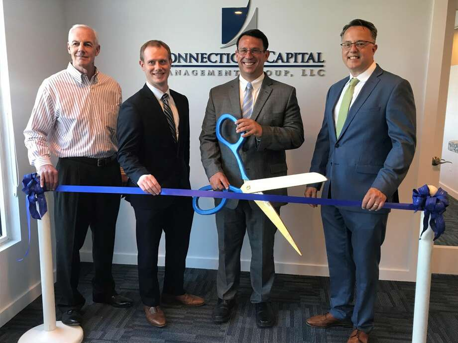 From left, Gary Mullin, Brian Parke, Mayor Ben Blake and Eric Tashlein cut the ribbon celebrating Connecticut Capital Management Group's 20th anniversary and new location.