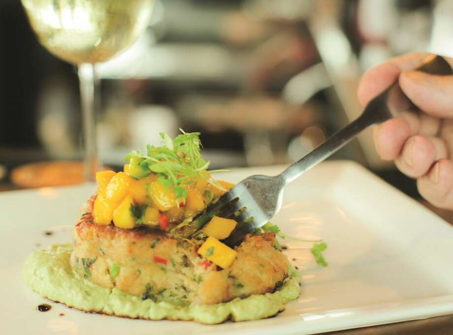 The Lobster Trap Crab Cake with Avocado Cream and Mango Salsa