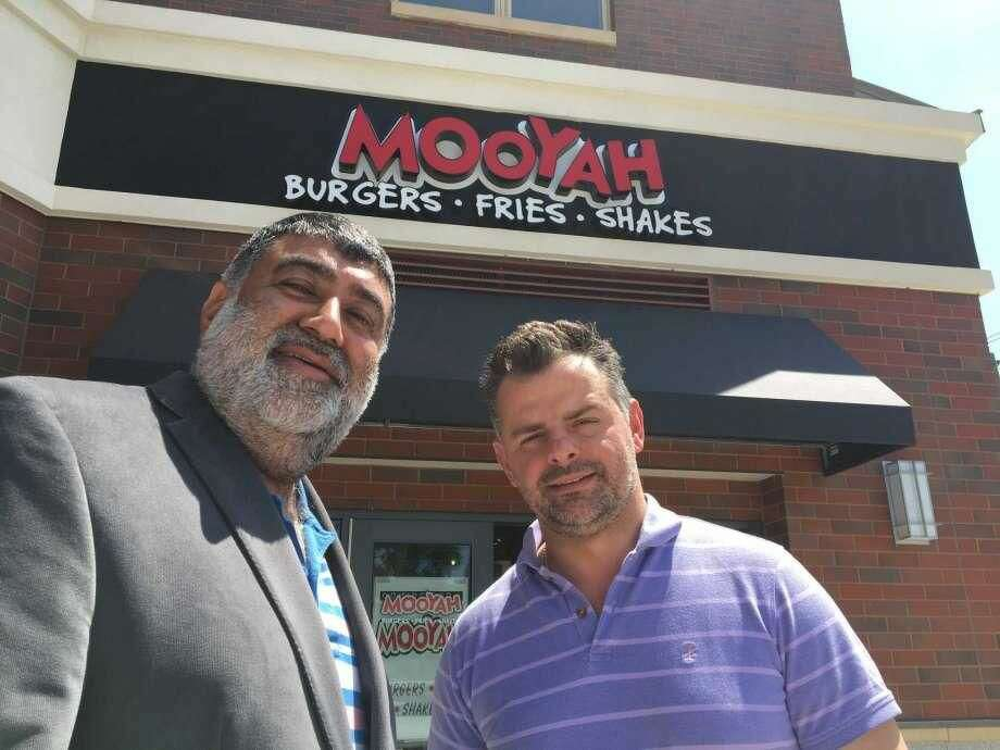 Mooyah Burgers franchise owner Prakash Wadwhani and General Manager Anton Tomaj outside the new West Haven restaurant.
