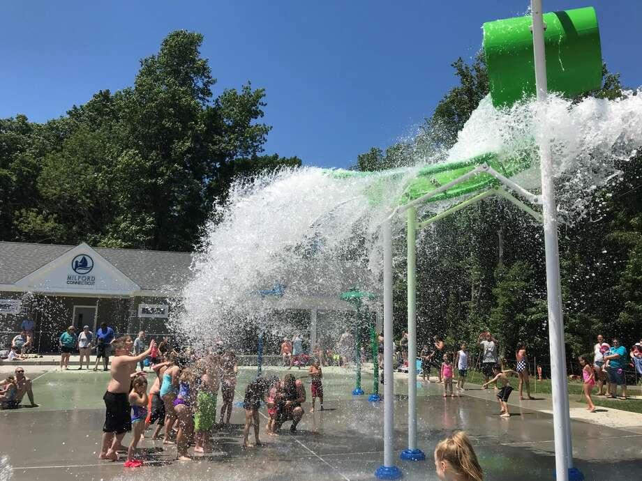 Kids enjoy splashing to beat the heat at Eisenhower Park.