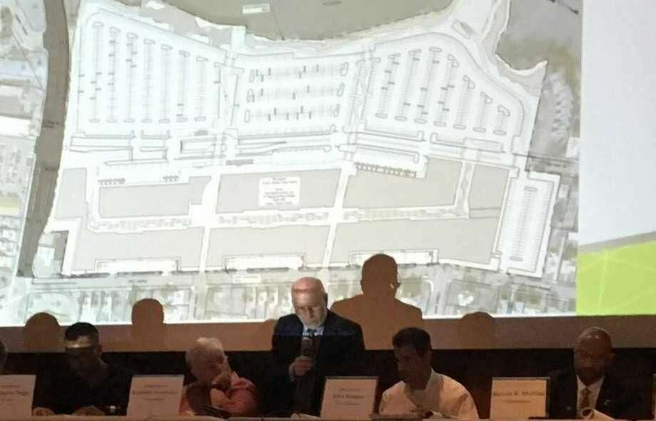 West Haven Planning and Zoning Commissioner members talk about The Haven project on Tueday, July 10, , with a map from the project's site plan projected on a screen behind them.