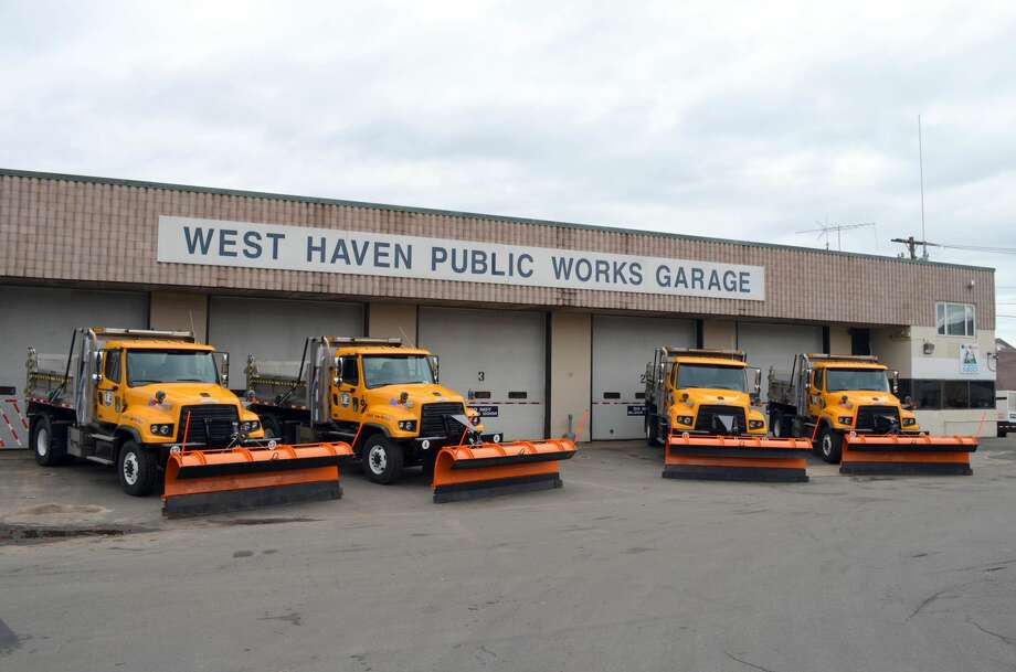 City trucks parked outside the West Haven Public Works Garage on Collis Street in West Haven.