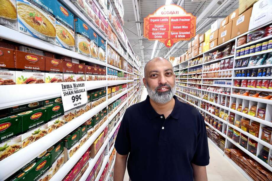 Yousuf Bokhary, owner of India Market, in the store in Orange.