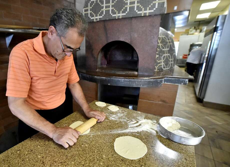 Owner and chef Adnan Akil works at his Bab Al Salam Restaurant on Bull Hill Lane in Orange.