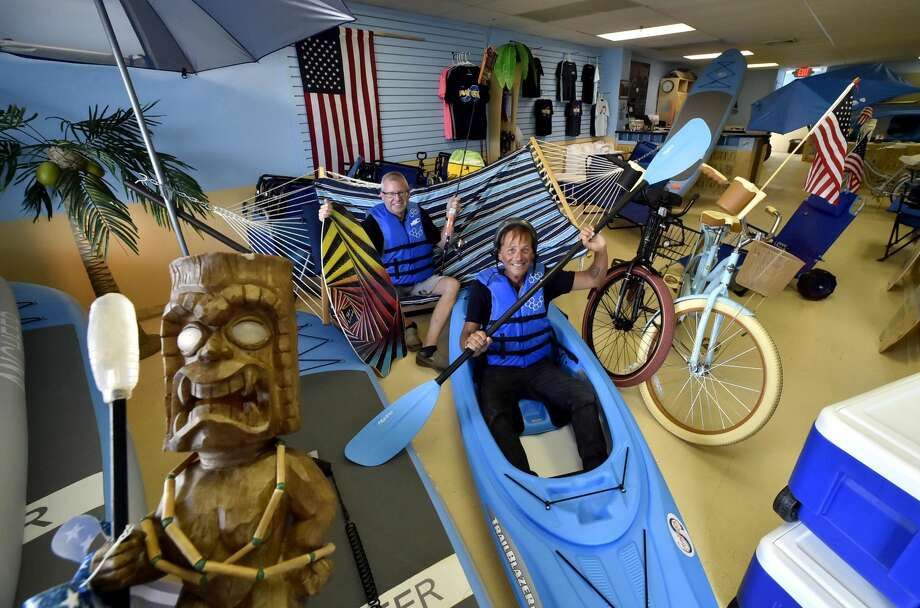Kevin Darcey, left, and George Curtis, owners of the Savin Rock Surf Shop in West Haven, who have started West Haven's first beach equipment rental shop for West Haven beaches.