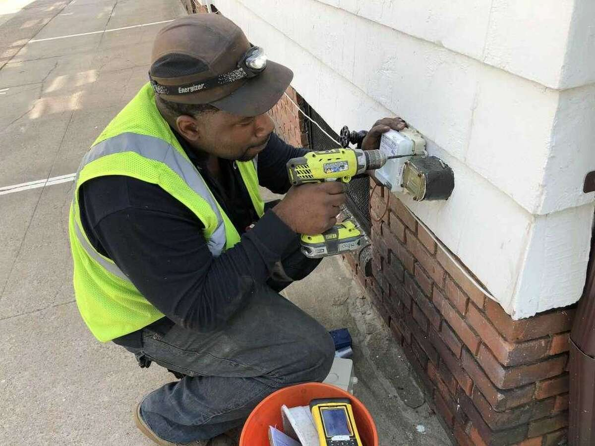 About 13,000 South Central Connecticut Regional Water Authority customers in West Haven are about to get the water industry's latest metering technology installed beginning next month. Here is an installer doing necessary work outside a customer's house.