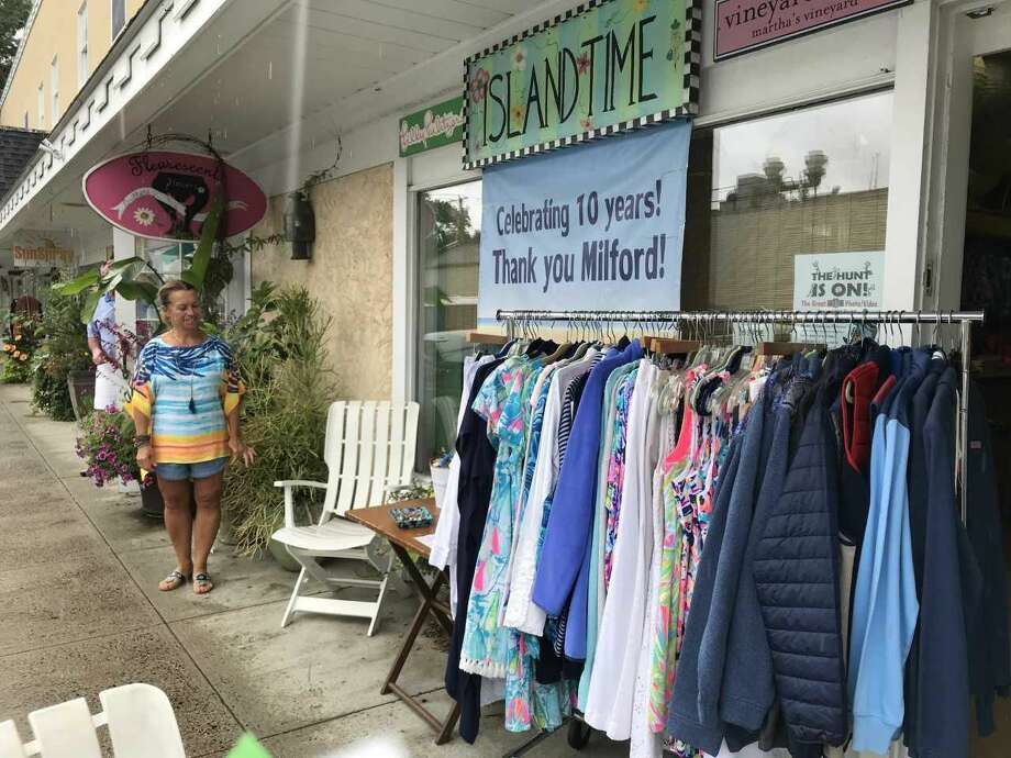 Susan Stanek, co-owner of Island Time, peruses bargains at the Milford Sidewalk Sale.