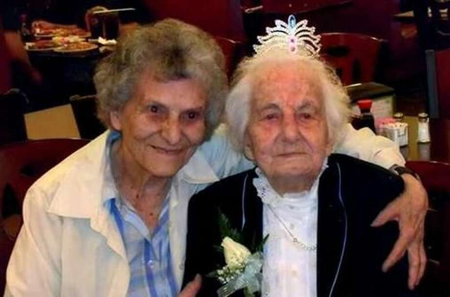 Jennie Recchia Marchitto, right, shown here with her niece Justina Marchitto, wore a tiara at her 100th birthday party. Marchitto, who for years before moving in with her daughter in Guilford was West Haven's oldest active Republican, died Tuesday, Aug. 14 at age 102. She was laid to rest Friday.