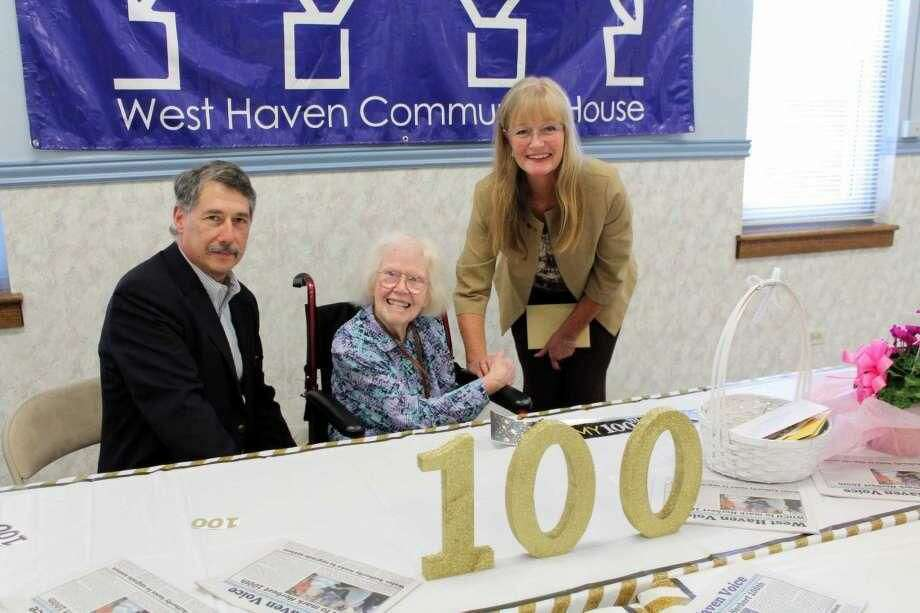 Patricia Pat Herbert celebrates her 100th birthday on Tuesday, Aug. 22, with William Heffernan, president of the West Haven Community House board of directors, and Mayor Nancy Rossi during a reception attended by dozens of colleagues, family and friends at the Community House.