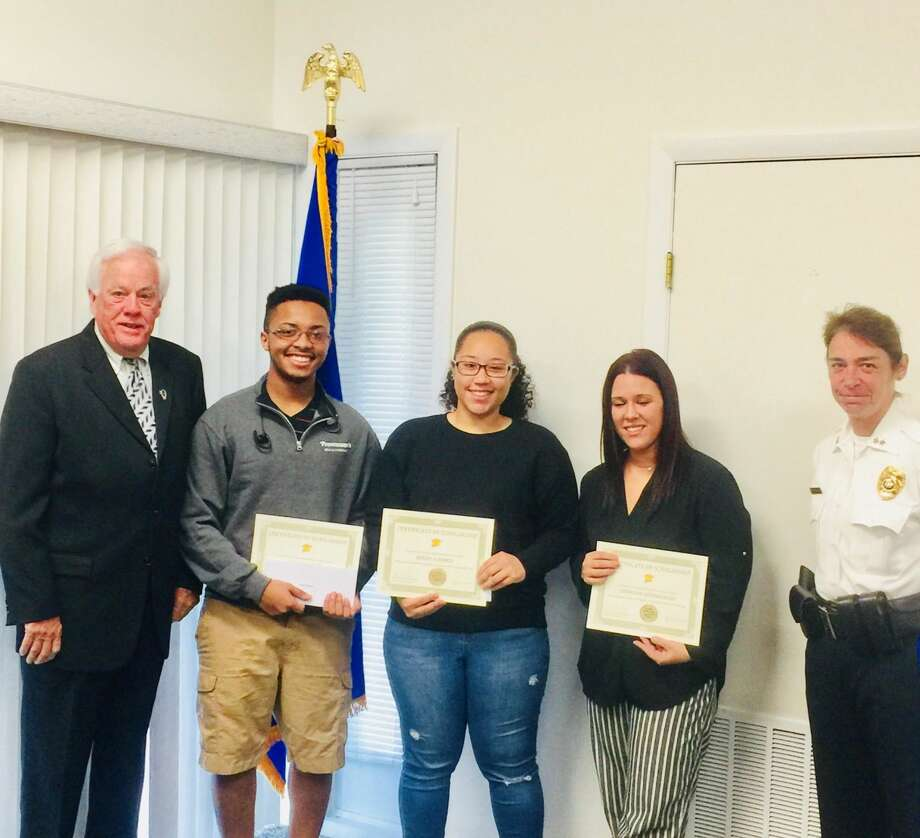 West Haven Housing Authority scholarship recipients Kobe Brantley, 2nd from left, Mikayla Ramos and Georgine Hendrickson pose Thursday morning with Housing Authority Vice Chairman John R. O'Connor, far left, and authority member and University of New Haven Police Chief Tracy L. Mooney, far right.