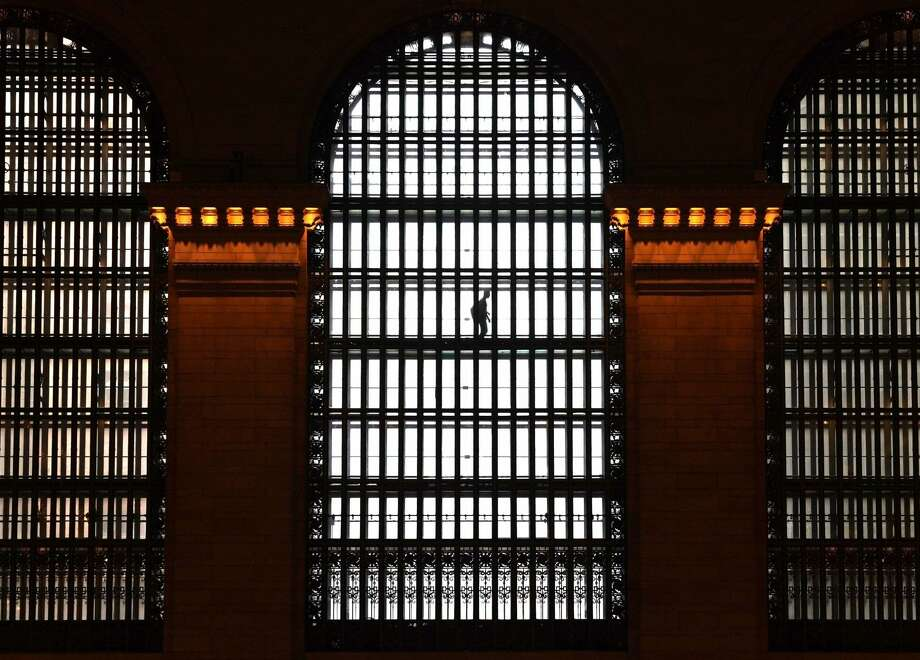 A person makes his way on one of the elevated glass walkways at Grand Central Terminal in New York City.