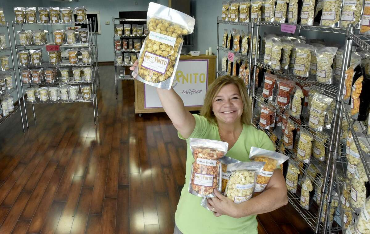 Stephanie Dudding, owner of Inpopnito, in the new shop that sells gourmet flavored popcorn at 3 River St. in Milford.