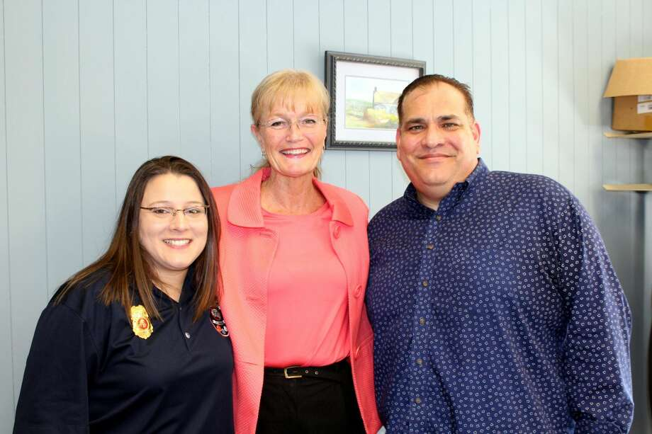 West Haven Mayor Nancy Rossi, center, congratulates 911 dispatcher Jennifer Amendola, left, on her promotion to director of the 911 Communications Center and outgoing Director Abe Colon, right, on his impending retirement.