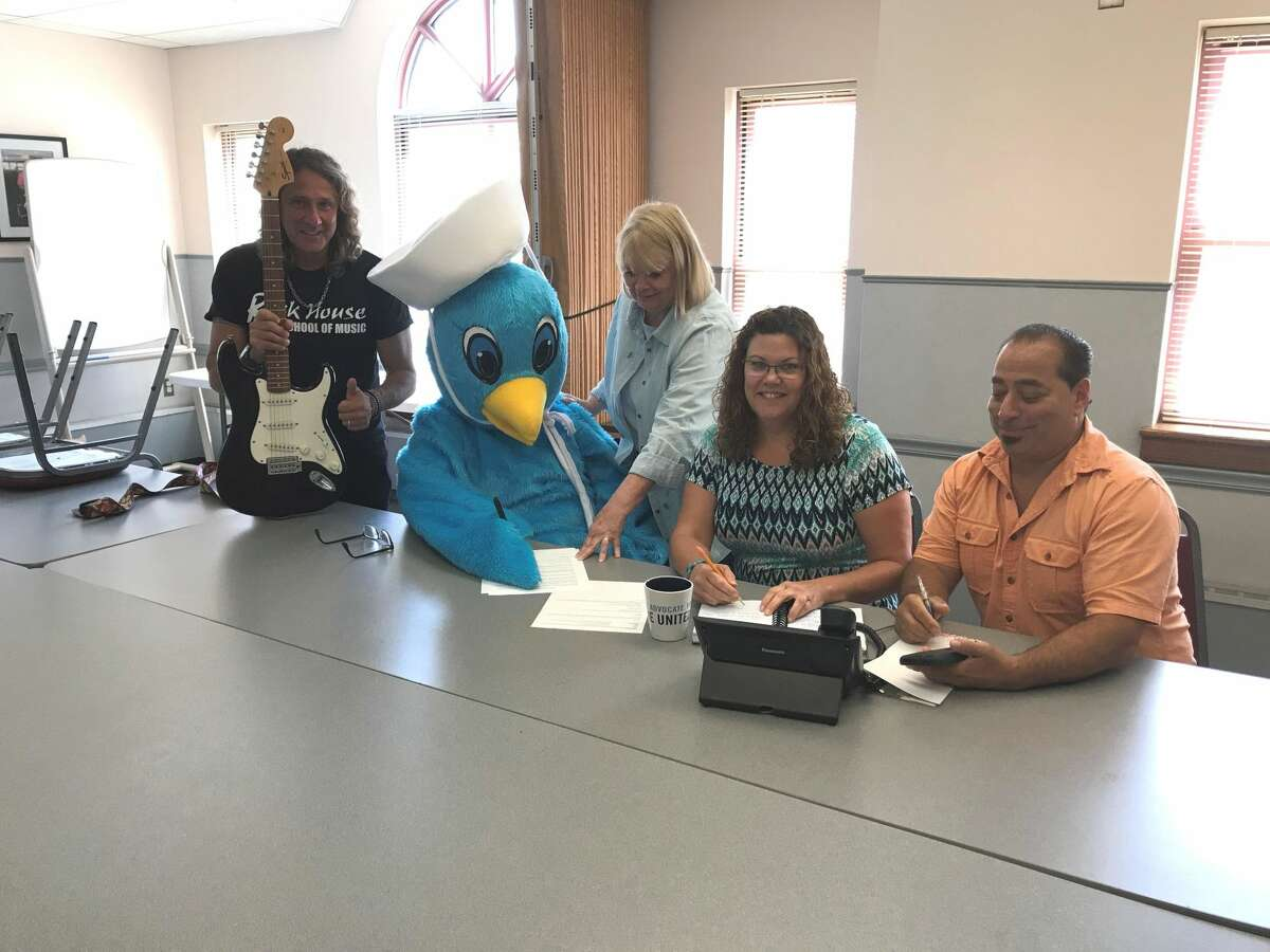 """Organizers off the West Haven Community House's upcoming Rock & Stroll fundraiser, featuring the 7th Annual Family Fun Walk and a new music festival, at a recent meeting. From left, John McCarthy from Rock House School of Music, Family Fun Walk mascot Sammy the Seagull, West Haven Community House Executive Director Patty Stevens and Marketing Director Kathy Hart-Jones, and John """"Johnny Z"""" Ziada from Zs Corner Cafe."""