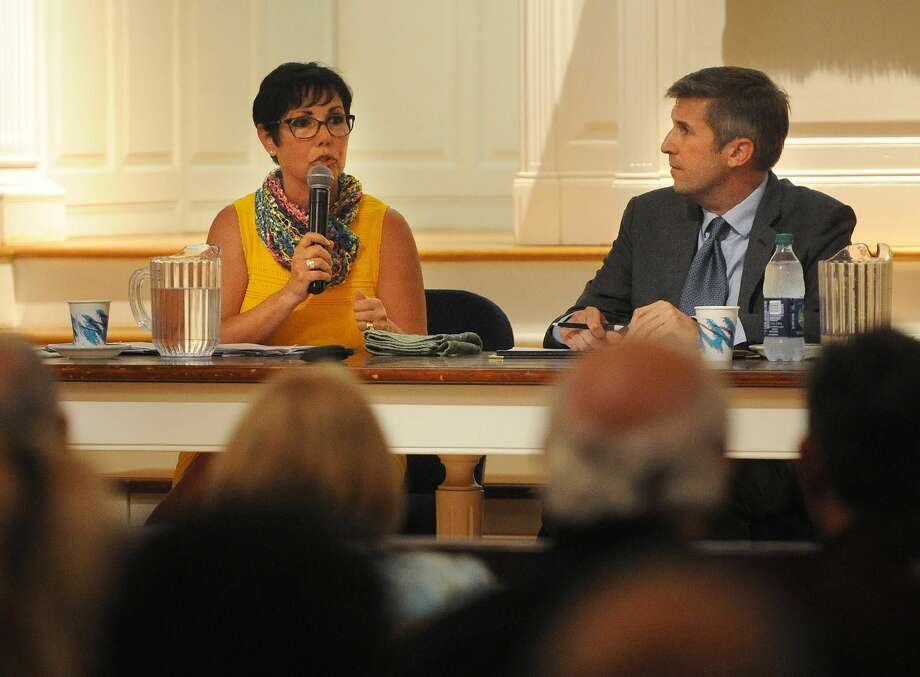 Republican Pam Staneski, left, and Democrat James Maroney, candidates for 14th distrrict state senator, square off in a debate at the First United Church of Christ in Milford on Monday, Sept.17.