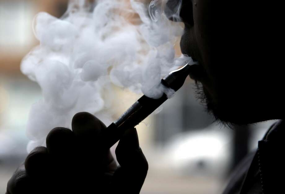 """Continuing to take aim at the """"epidemic"""" of e-cigarette smoking among young people, the U.S. Food and Drug Administration has launched """"The Real Cost"""" Youth E-Cigarette Prevention Campaign. (AP Photo/Nam Y. Huh, File)"""