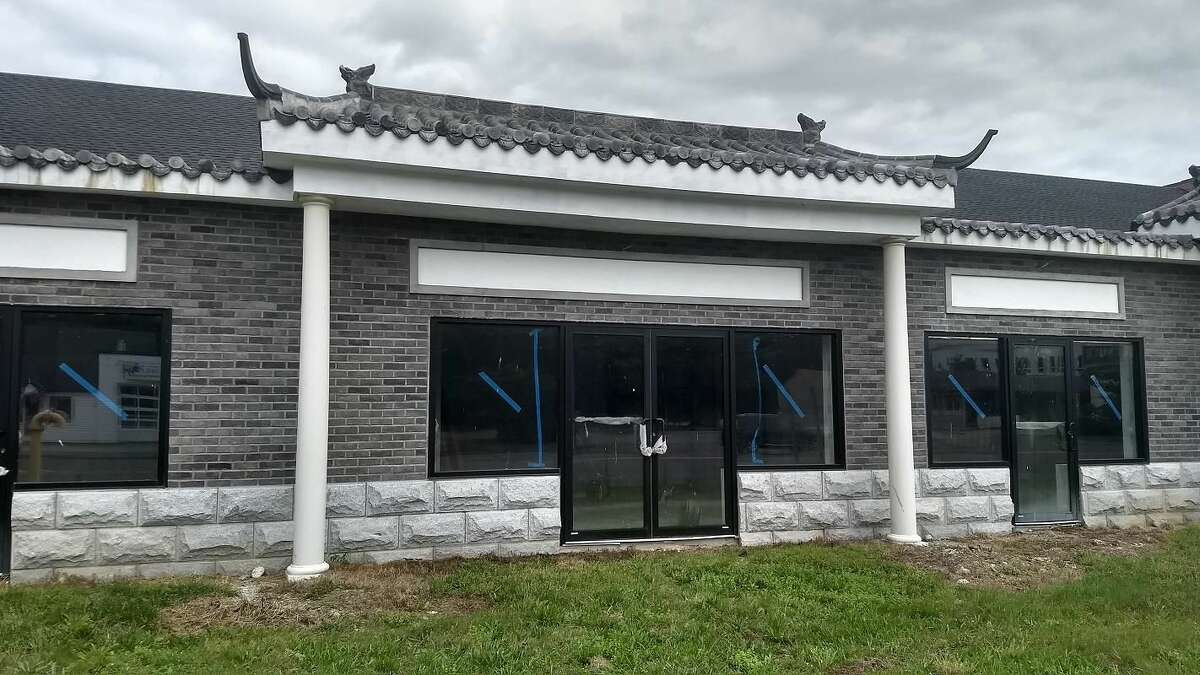 A close-up view of new Asian marketplace under construction, whose owners face heftyfines for letting the site fall into disrepair, in violation of the city's blight ordinance.