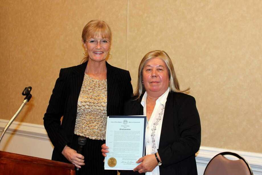 West Haven officials and elected state representatives joined elderly services advocates Wednesday, Sept. 26, to mark the 50th Anniversary of the Allingtown and West Haven senior centers during a luncheon in the Cielo Banquet Hall Ballroom. Mayor Nancy Rossi presented a proclamation commemorating the centers golden anniversary to Elderly Services Director Sharon Mancini, right.