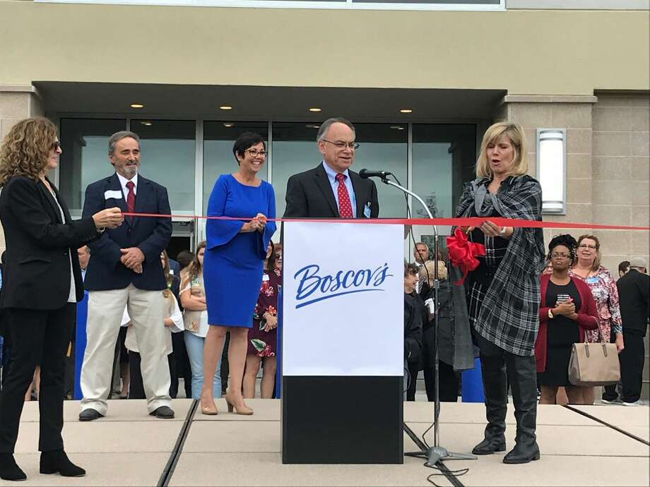 Jim Boscov with singer Debbie Boone at the ribbon-cutting.
