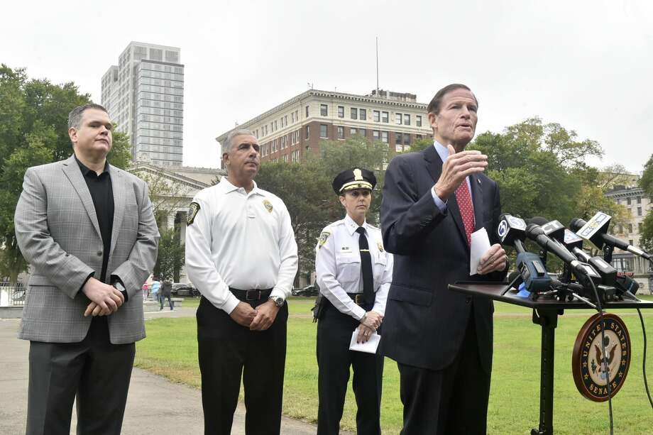 U.S Sen. Richard Blumenthal, D-Conn., right, with, from left, Robert F. Lawlor Jr., drug intelligence officer with the New England High Intensity Drug Trafficking Area; Rick Fontana, director of the New Haven Office of Emergency Management; and New Haven Police Department Assistant Chief Rachael Cain during a news conference Monday on the New Haven Green announcing a federal opioid bill.