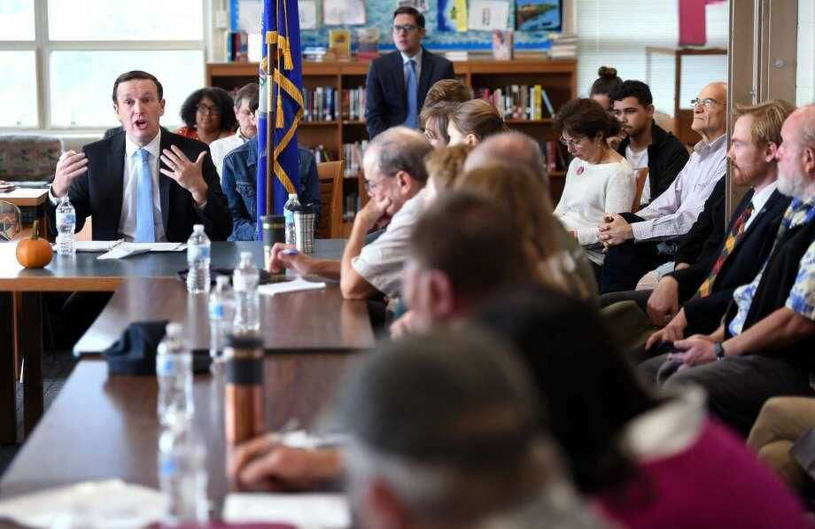 U.S. Sen. Chris Murphy, left, speaks at the Sound School in New Haven Friday about the Long Island Sound Restoration and Stewardship Act that just passed in Congress.