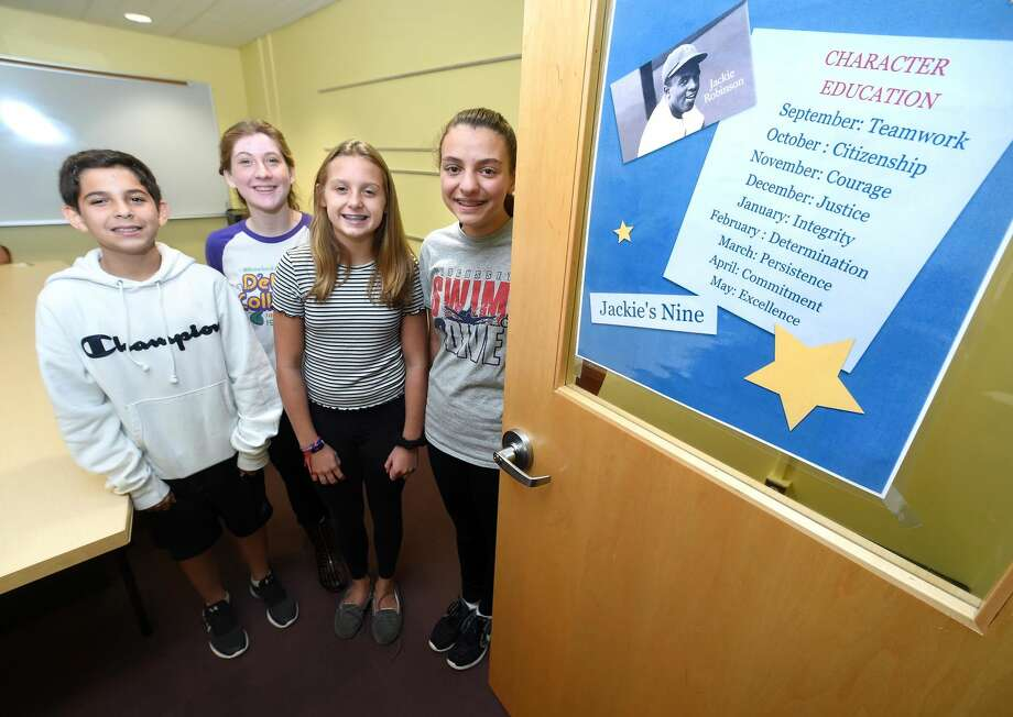 From left, , Amity Middle School eighth graders Jesse Palermo, Zoe May, Emma Kirck and Cassidy Smith were honored for their teamwork at school. The school is using the Jackie Robinson character program and teamwork was the character of the month.