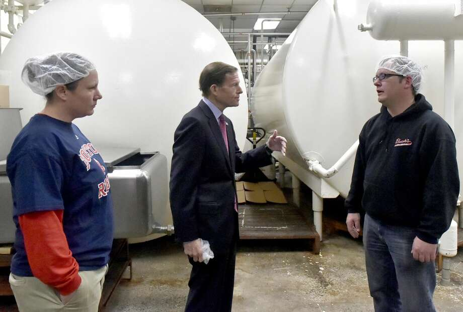 Sara Buck, left, and her brother Chris Buck, right, both of Buck's Ice Cream manufacturing plant in Milford, give U.S. Senator Richard Blumenthal (D-Conn.), center, a tour of the plant on Pepe's Farm Road. Buck's Ice Cream was awarded the Small Business Adminstration 2018 Family Owned Connecticut Business of the Year.