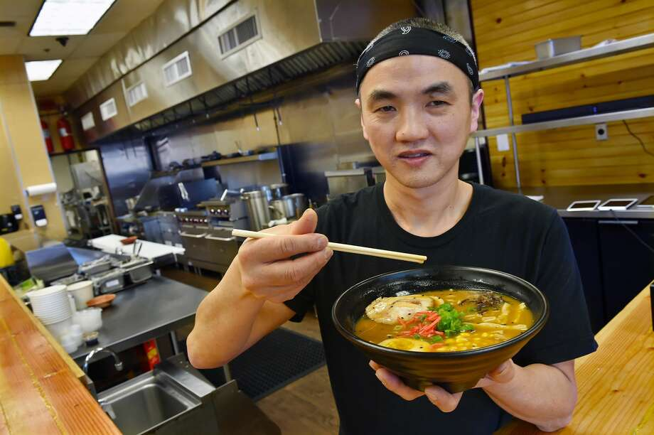 Orange resident Jimmy Pin, co-owner of Hokkaido Ramen at 297 Boston Post Road in Orange, displays a bowl of spicy miso ramen.