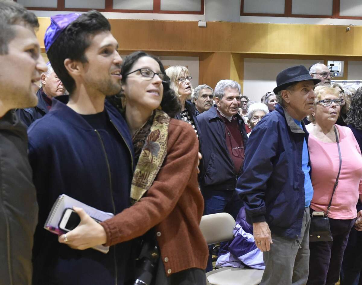 Hundreds of people attended a vigil at the Jewish Community Center in Woodbridge Sunday evening in response to the Pittsburgh Synagogue shooting Saturday.
