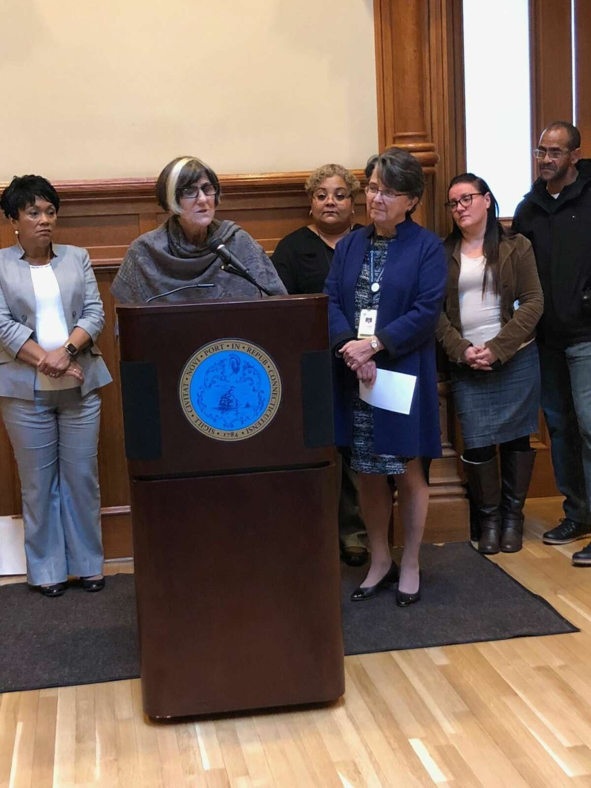 U.S. Rep. Rosa DeLauro, D-3, at podium, reminds residents to sign up for the Affordable Care Act. Far right is Pedro Garcia, who was able to get retroactive coverage when he discovered he had a heart issue. He is next to his wife, Marisol Velez.