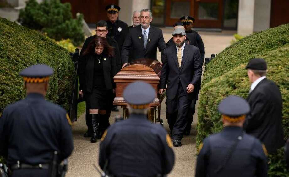 The casket of Irving Younger is led to a hearse outside Rodef Shalom Temple following his funeral on Oct. 31 in Pittsburgh, Pennsylvania. Irving Younger was one of 11 people killed in the mass shooting at the Tree of Life Synagogue on Oct. 27.